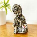 Estátua Buddha Criança Descansando - Cabeça no joelho
